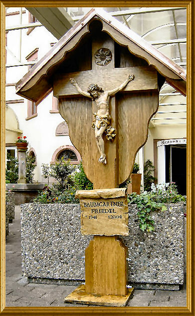 Grave cross made of oak with painted wooden statue of Christ